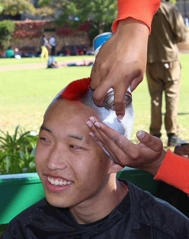 Adrian Song, 1st Biokinetics health science, decided to spray his hair in support of the shavathon. Photo: Prelene Singh