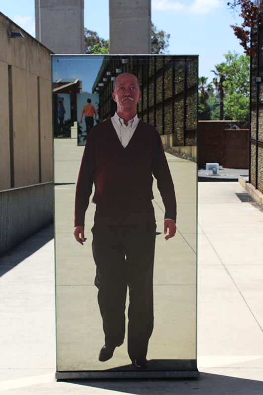 I took a photo of this man as he had facial features of an Asian man. And the only one that I spotted on the ramp of infinity. This ramp represented the journey of generations passed and presently. The mirrored boards had photo's of the children, grandchildren and great-grandchildren of some of those who journeyed to Johannesburg following the discovery of gold in 1886. This photo is significant because it represented the far stretched history of Chinese people in Johannesburg. The ramp is built in such a way to represent the mining industry at the time and how miners were treated with the feeling of imprisonment as you walk up the ramp. Through my research I know that the Chinese were brought South Africa early in the 20th century as miners because the locals refused to mine under the inhumane conditions. Photo: Prelene Singh